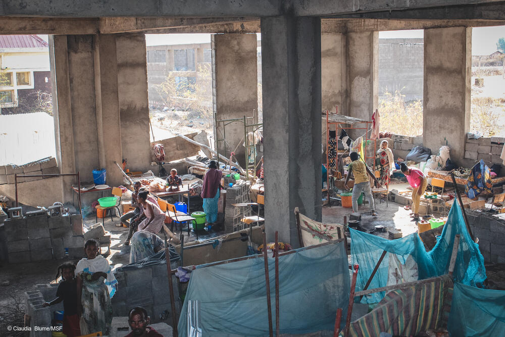 Hundreds of people in Shire's University IDP site live in an unfinished building, where they sleep, cook and eat.