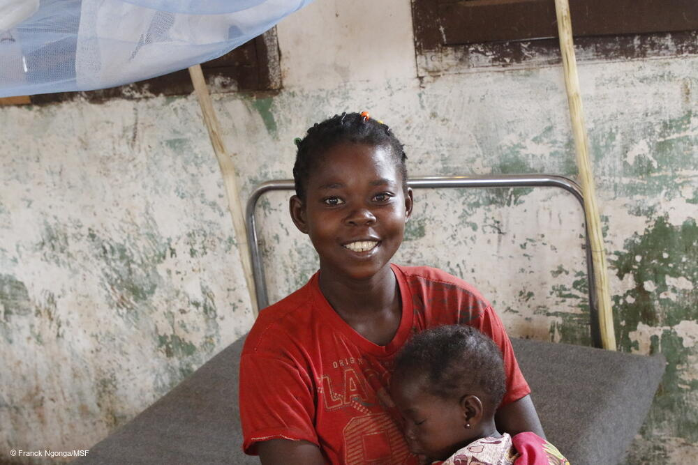 Bibiche is holding her 2-year old daughter Sandrine at the Bosobolo General Referral Hospital. Sandrine was hospitalized here as she suffered from measles, but the child is feeling better now.