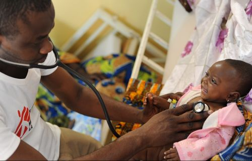 5 month old Sani is examined by Dr Hypolitte Ten  in Maradi, Niger