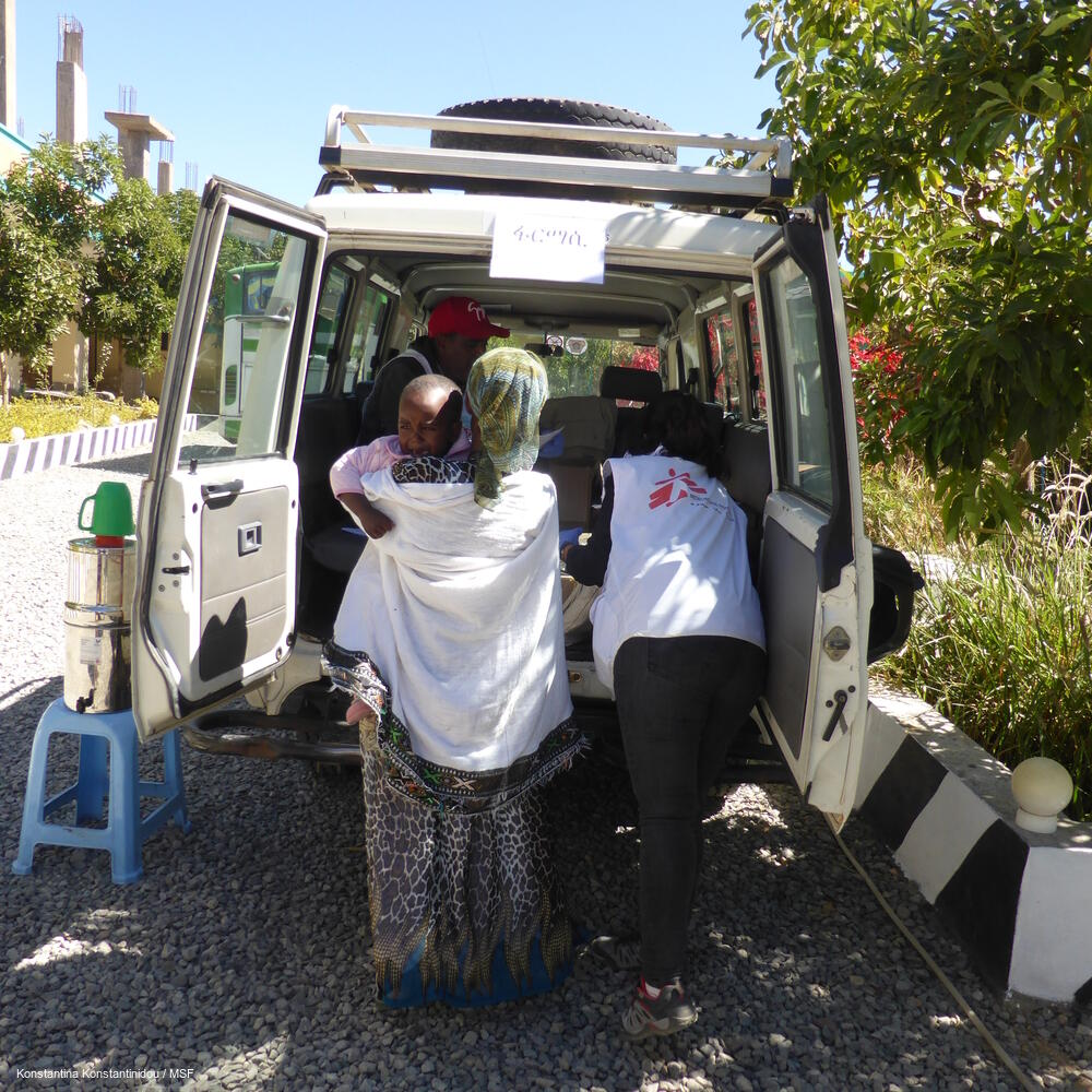 MSF staff transport a patient during a mobile clinic in Hawzen, northeast Tigray