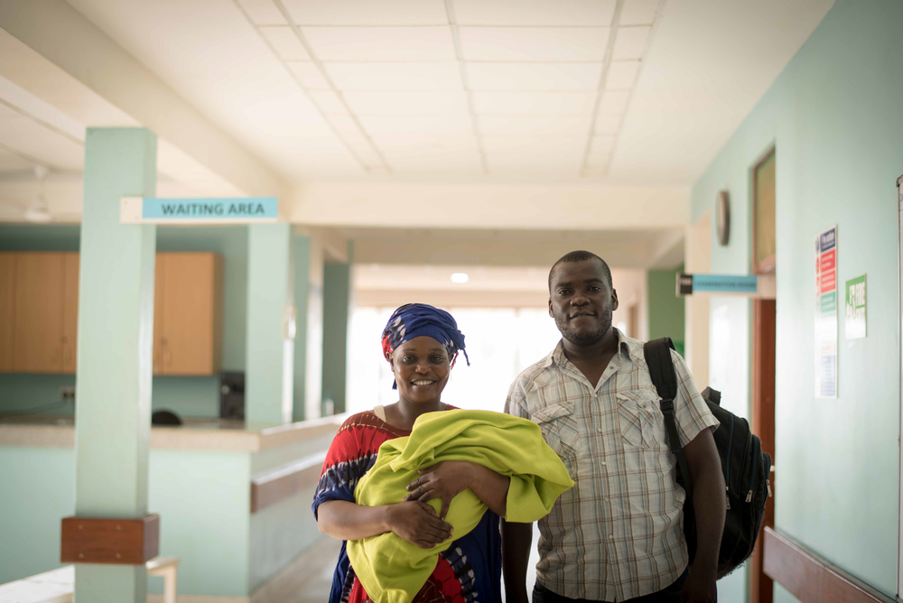 Roselyn with her daughter, Hope, and husband as they prepare to leave the Mrima Health Centre.