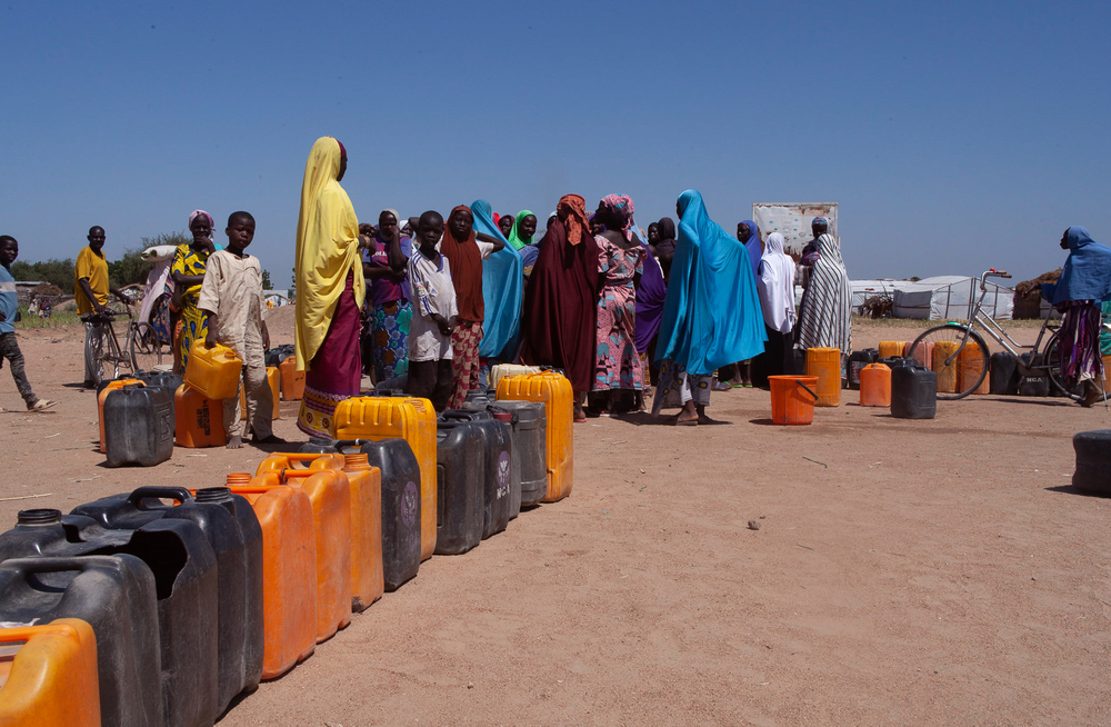 Women queue up at a borehole in Gwoza to collect water.© Scott Hamilton/MSF