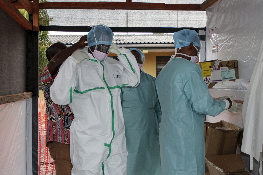 Medical staff dress with PPE to enter the treatment unit