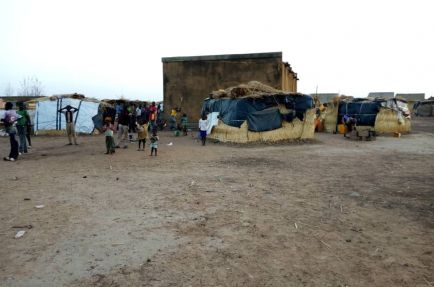 Displaced families live in makeshift shelters in Fada,