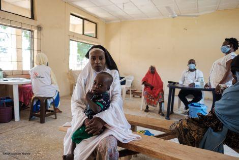 Sadiya M. with her 1.5 y/o son waiting for treatment in Anka MSF hospital, Zamfara state
