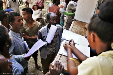 Administrators register newly arrived displaced people at Tsegay Berhe