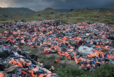 Thousands of life jackets left behind by arriving migrants are gathered at a dump on Lesbos Island, Greece.  [ © Robin Hammond/Witness Change]