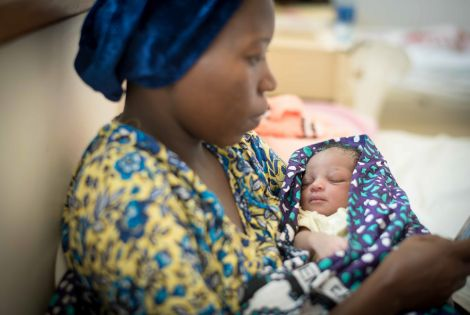 A mother with her new-born in Mrima Hospital