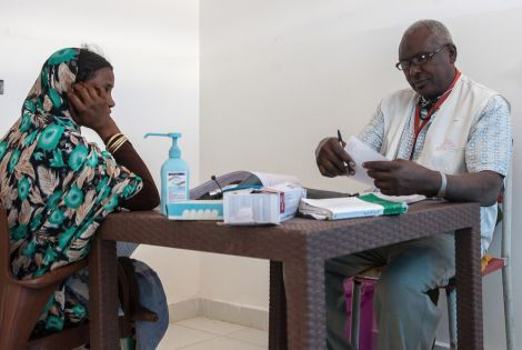 Nutrition assistant Abubakar Sediq prepares a prescription for a woman after examining her in MSF's new hospital in Al Kashafa refugee camp, in Sudan's White Nile state.[Photo: MSF/Musab Sahnon]