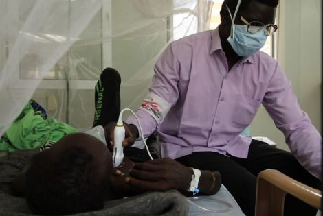 An MSF staff uses the point-of-care-ultrasound to check vital signs in Malakal, South Sudan