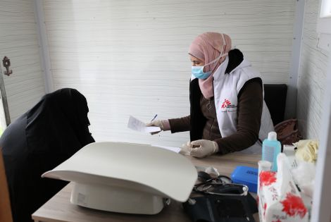 An MSF nurse talks to a woman during a consultation at MSF's mobile clinic, Northwest Syria