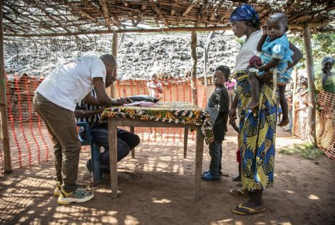 Families register for the measles vaccination campaign in the village of Botulu, Boso Manzi health zone