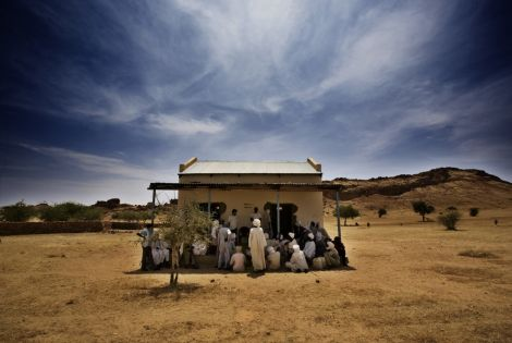 An MSF team talks to a group of men in Dar Zaghawa, in North Darfur state